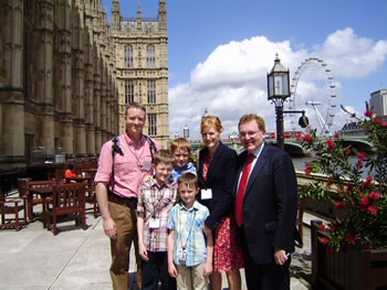 MR MUNDELL IS PICTURED WITH SHIONA AND ROBBIE GRIEVE AND THEIR THREE CHILDREN ON THE TERRACE AT THE HOUSE OF COMMONS.